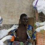 Nurses Examine Ebola Patient