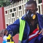 Ebola Response Worker with a Respirator and No Gloves