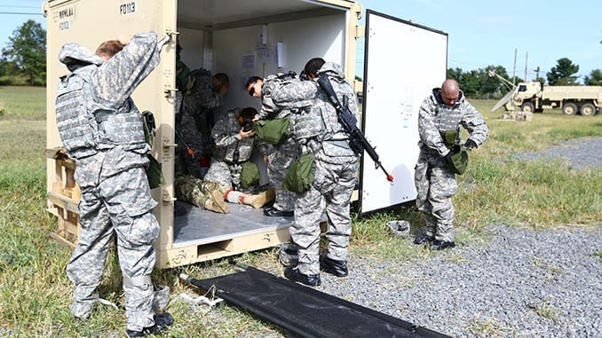 1st AML personnel assist a victim of indirect fire during the tactical portion of their Certification Training Exercise.