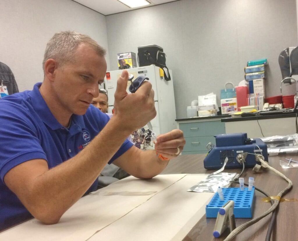 CSA astronaut David Saint-Jacques preparing a sample during pre-flight training