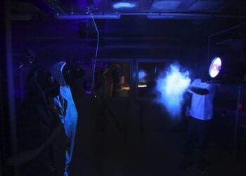 Glo Germ, Party-Poppers, and a Black Light: Biologists Develop Rad Plan to Test Protective Suits